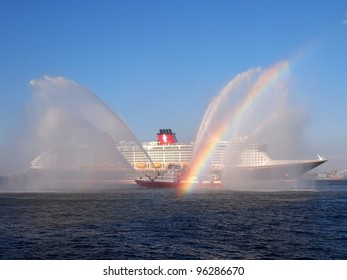 NEW YORK - FEBRUARY 28: Disney Fantasy, a new cruise ship, is greeted by a fireboat as it enters New York Harbor, February 28, 2012. The 130,000-ton vessel is the 4th Disney Cruise Line ship.