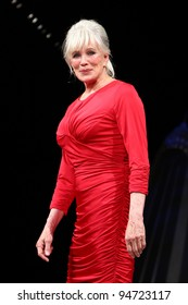 NEW YORK - FEBRUARY 8: Linda Evans wears Tadashi Shoji at The Heart Truth's Red Dress Collection 2012 Fashion Show at the Hammerstein Ballroom on February 8, 2012 in New York City.