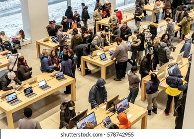 New York, February 9, 2017: People are browsing inside Apple store on 5th Avenue.