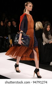 NEW YORK - FEBRUARY 9: Model Nimue Smit walks the runway at the BCBG Max Azria FW 2012 Collection presentation during Mercedes-Benz Fashion Week on February 9, 2012 in New York.