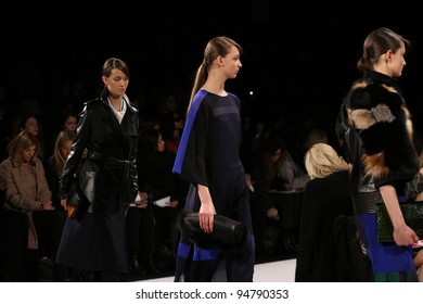 NEW YORK - FEBRUARY 9: Models walk the runway at the BCBG Max Azria F/W 2012 Collection presentation during Mercedes-Benz Fashion Week on February 9, 2012 in New York.
