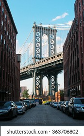 New York: iconic view of Manhattan Bridge from Dumbo neighborhood on September 16, 2014. The Manhattan Bridge, known as the famous landmark, opened to traffic in 1909 and has a main span of 1470 feet