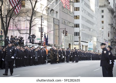 NEW YORK - JAN 13 2017: NYPD Det. Steven McDonald funeral procession and service at St Patricks Cathedral, 5th Avenue, Manhattan - Law enforcement personnel and dignitaries line 5th Ave.