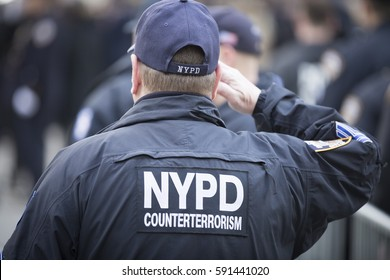 NEW YORK - JAN 13 2017: NYPD Det. Steven McDonald funeral procession and service at St Patricks Cathedral, 5th Avenue, Manhattan - NYPD Counter Terrorism Bureau personnel salute.