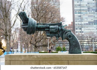 NEW YORK - JAN 28 : Non Violence Sculpture at United Nations Headquarters Building on Jan 28, 2017 in Manhattan, New York, USA.