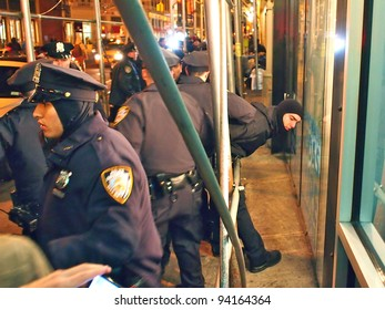 NEW YORK - JAN 29: Police detain a protester at an Occupy Wall Street march, January 29, 2012 in New York City. Demonstrators rallied to protest police action earlier that weekend at Occupy Oakland.