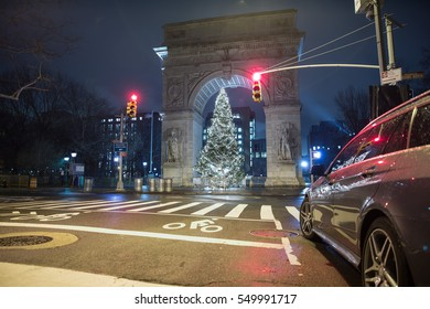 NEW YORK - JAN 3, 2017: red lights at crosswalk in front of Washington Square North Christmas tree under arch in NYC. The public park is among 1,900 in the city and is located in Greenwich Village.