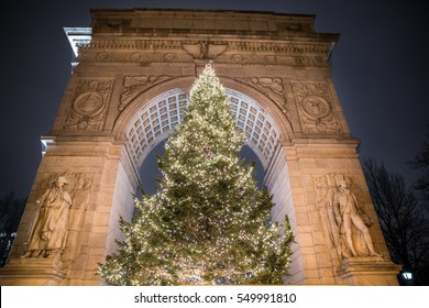 NEW YORK - JAN 3, 2017: beautiful large Christmas tree lights at night under Washington Square Park arch in Manhattan, NYC. Of all the city's 1,900 public parks, WSP is perhaps the most popular.