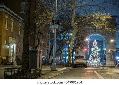 NEW YORK - JAN 3, 2017: beautiful Christmas tree on Lower 5th Ave under arch of WSP North in NYC. Washington Square Park is one of the most popular public parks in the 5 boroughs.