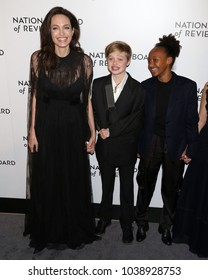 NEW YORK - JAN 9, 2018: Angelina Jolie, Shiloh Jolie Pitt and Zahara Jolie Pitt attend the National Board of Review Awards at Cipriani on January 9, 2018, in New York