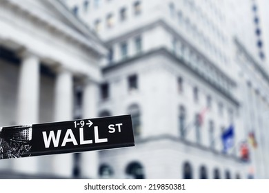 New York, January 20, 2014 - Wall Street sign in Manhattan