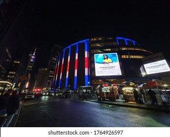 NEW YORK - JANUARY, 2020: Night streetscene of the Madison Square Garden and the Empire State Building in NYC.