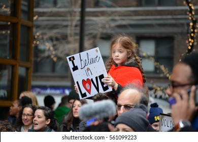 New York, New York. - January 21, 2017: Child holding a sign during the Women's March on New York City  in Manhattan in 2017 in New York City.