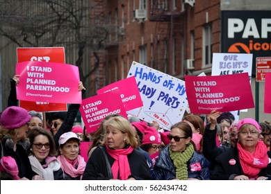 New York, New York. - January 21, 2017: People carrying signs at the Women's March for equal rights in Manhattan in 2017 in New York City.