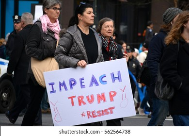 New York, New York. - January 21, 2017: People carrying signs at the Women's March for equality in Manhattan in 2017 in New York City.