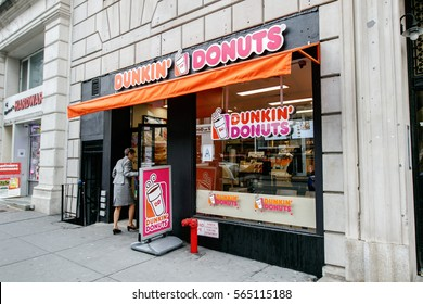 New York, January 21, 2017: A woman is walking into a Dunkin Donuts store on west 72 street in Manhattan.