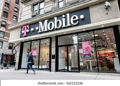 New York, January 21, 2017: A woman is walking by a T Mobile store in Manhattan.