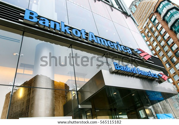 New York, January 21, 2017: Bank of America signage on a glass facade of a building above the entrance to their branch.