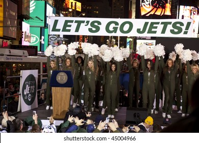 NEW YORK - JANUARY 21: Jets flight crew perform at the New York Jets AFC Championship game pep rally in Times Square on January 21, 2010 in New York City.