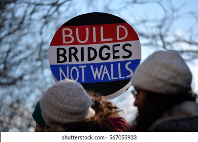 New York, New York. - January 29, 2017: People participating in the protest march against President Trump's new immigration laws in Manhattan in 2017 in New York City.