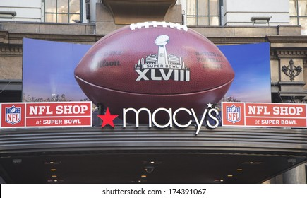 NEW YORK - JANUARY 30: Giant Football at Macy's Herald Square on Broadway during Super Bowl XLVIII week in Manhattan on January 30, 2014. Macy's Herald Square is an official NFL shop at Super Bowl