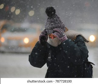 NEW YORK, NEW YORK- JANUARY 4, 2018:  People bundle up against the cold in the Soho section of Manhattan, as a winter storm called a Bomb Cyclone,  hits the city.
