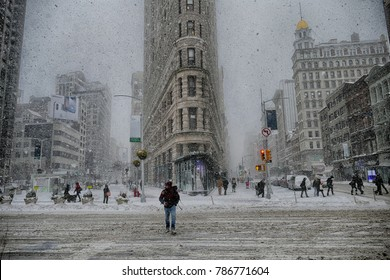 "NEW YORK - JANUARY 4 : Flat Iron building during the ""Bomb Cyclone"" blizzard on January 4, 2018. Dubbed a ""historic bomb cyclone"", the blizzard dumped snow as far south as Florida."