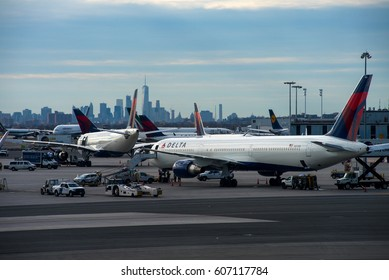 NEW YORK - JFK / USA - MARCH 2017 Delta Air Lines Boeing 767-432(ER), N830MH, cn 29701 / 803 being prepared for the next night-flight at busy JFK with NYs skyline visible in the background.