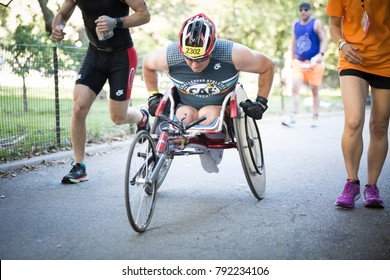 NEW YORK - JUL 16 2017: CAF athlete races through Riverside Park during the NYC Triathlon Race in Central Park. The run is 10k and the race is the only International Distance triathlon in NYC.