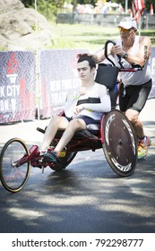 NEW YORK - JUL 16 2017: David and Blake Ferrell, father and son team, cross the finish line after completing the 1.5k swim, 40k bike, and 10k run of the Panasonic NYC Triathlon Race in Central Park.
