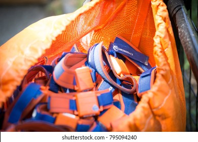 NEW YORK - JUL 16 2017: Hundreds of blue and orange ankle chromo bands that track the location and time of each athlete collected after athletes finish the NYC Triathlon Race in Central Park.
