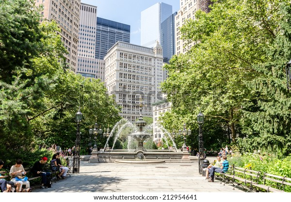 NEW YORK - JUL 17: City Hall Park on July 17, 2014 in New York City. This 8.8-acre downtown park is home to more than a dozen monuments.