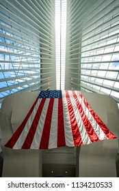 NEW YORK, NEW YORK - JUL 6:  American flag at the Oculus transportation hub at World Trade Center in New York City on July 6, 2018. The structure was designed by Santiago Calatrava.