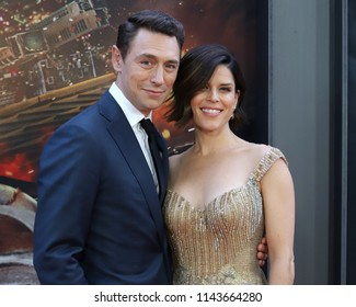 "NEW YORK - July 10, 2018:  Neve Campbell and JJ Feild attend the premiere of ""Skyscraper"" at AMC Loews Lincoln Square on July 10, 2018, in New York City."