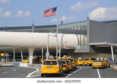 NEW YORK- JULY 10: New York Taxi line next to JetBlue Terminal 5 at John F Kennedy International Airport in New York on July 10, 2014.