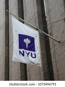 NEW YORK - JULY 11, 2017: NYU flag on David B. Kriser Dental Center in Lower Manhattan. NYU College of Dentistry is the third oldest continuously operating and the largest dental school in the USA
