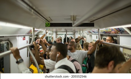 NEW YORK - JULY 14, 2014: passengers on MTA subway train in New York. The NYC Subway is a rapid transit/transportation system in the City of NY.