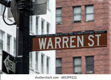 """NEW YORK - JULY 14, 2017: Street sign for Warren Street """"African Burial ground and the rest commons historic district"""" on July 14th, 2017 in Manhattan, New York, NY, USA"""