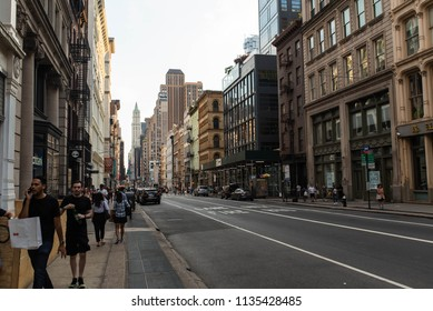 NEW YORK, NEW YORK - JULY 14, 2018: Walking around SoHo and Broadway street where this are various high end fashion brands and clothing stores in New York City.