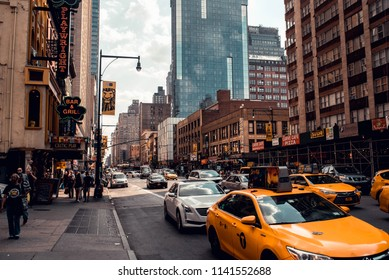 NEW YORK, NEW YORK - JULY 14, 2018: Rush hour in New York City depicting various modes of transportation like taxis, ridesharing, and more.