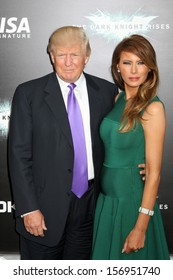 """NEW YORK - JULY 16: Donald Trump and Melania Trump  attend the premiere of """"The Dark Knight Rises"""" at AMC Lincoln Square Theater on July 16, 2012 in New York City."""
