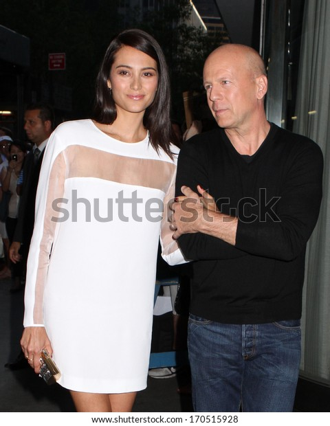 "NEW YORK - JULY 16: Emma Heming Willis and Bruce Willis attend a screening of ""Red 2"" at the Museum of Modern Art on July 16, 2013 in New York City."