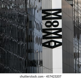 New York, July 19, 2016: Museum of Modern Art's sign is reflected by the glass windows of a high rise building.