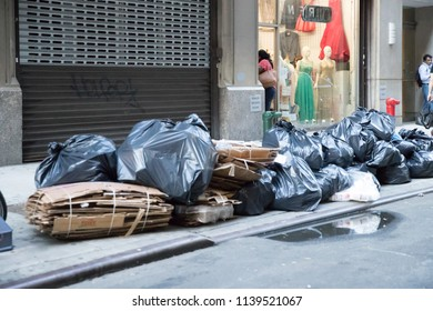 New York, July 19, 2018: Garbage bags on the sidewalk in New York City, USA