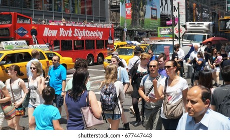 NEW YORK, NEW YORK - July 2, 2014: New York City Street Scene. Everyday people crossing a busy intersection near Times Square in New York City.