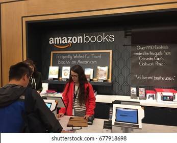 NEW YORK - JULY 2017: Amazon Books store clerk behind counter & customer pays w Amazon Prime in  brick-and-mortar store Time Warner Center. E-commerce giant sells Kindles, Fire tablet, Echo & Fire TV