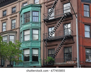 NEW YORK - JULY 2017:   The Brooklyn Heights area has been protected, and has numerous houses dating back to the early 1800s.