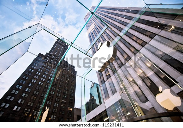 NEW YORK - JULY 21: Apple store on Fifth Avenue on July 21 2012 in New York City, USA. The store in it self is all underground except for the 32-foot glass cube right in front of f the GM building