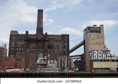 NEW YORK - JULY 21: The Domino Sugar Factory in Brooklyn, NY on July 21, 2013. The planned development of the plant into apartments has been met with protest from many in the neighborhood.