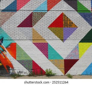 NEW YORK - JULY 24, 2014: Mural art in Astoria section in Queens.A mural is any piece of artwork painted or applied directly on a wall, ceiling or other large permanent surface